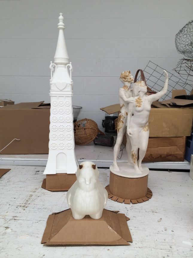 "I had three 3D Printed PLA pieces to cast altogether- A 24"" tall Luna Park Tower (printed in sections), Mat Fraser and Julie Atlas Muz 18"" tall figure (printed on Makerbot's Z-18 printer), and the Zee figurine. I used some cardboard and hot glue to piece together a reservoir for each print before going to make a mold around each."