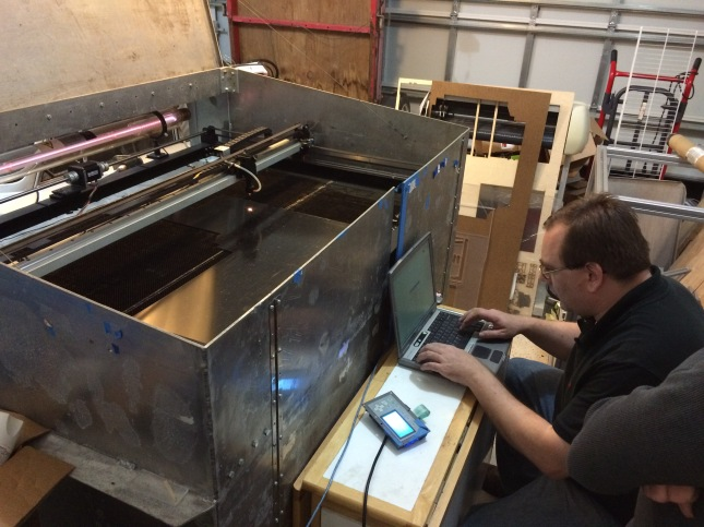 Before I left he had to cut a couple last minute plexiglass parts on his homemade laser cutter, built into a surplus Navy shipping container